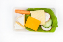 Cheese plate with fresh vegetables